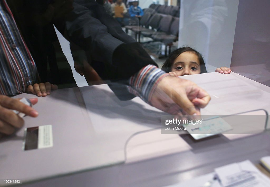 Malaika Chaudhary, 3, who's parents immigrated from Pakistan, stands with her father during an interview at the U.S. Citizenship and Immigration Services (USCIS), district office on January 29, 2013 in New York City. Some 118,000 immigrants applied for U.S. citizenship and 2,500 children received citizenship certificates in the New York City dictrict in 2012. Although underage children of naturalized immigrants usually receive U.S. citizenship, they must go through a process at the USCIS in order to receive legal certificates. Children born in the United States are American, regardless of the immigrant status of their parents.