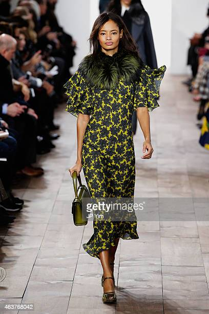 Malaika Firth walks the runway at the Michael Kors fashion show during MercedesBenz Fashion Week Fall at Spring Studios on February 18 2015 in New...