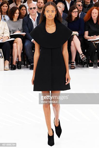 Malaika Firth walks the runway during the Christian Dior show as part of Paris Fashion Week Haute Couture Fall/Winter 20142015 at Muse Rodin on July...