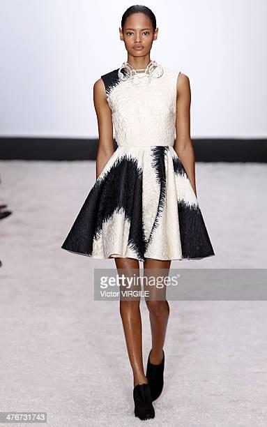 Malaika Firth walks the runway during the Giambattista Valli Ready to Wear Fall/Winter 20142015 show as part of the Paris Fashion Week Womenswear...