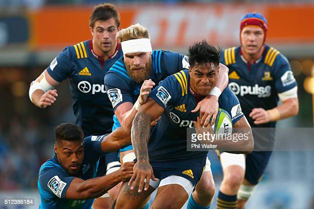 Malakai Fekitao of the Highlanders is tackled during the round one Super Rugby match between the Blues and the Highlanders at Eden Park on February...
