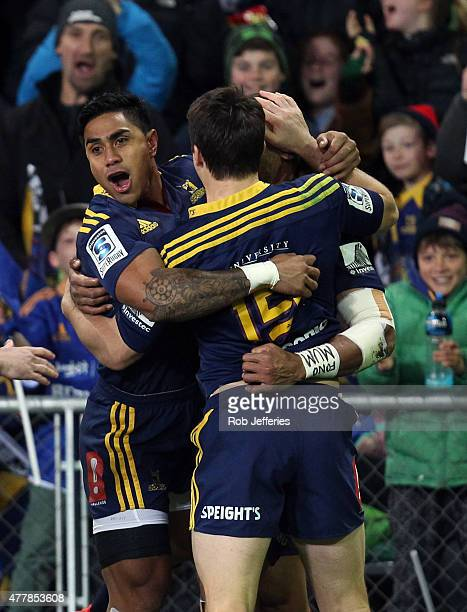 Malakai Fekitoa and Ben Smith of the Highlanders celebrate the try of Patrick Osborne which was subsequently denied during the Super Rugby Qualifying...