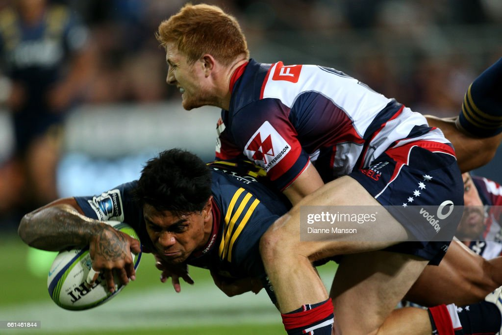 Malakai Fekitoa dives over to score a try while in the tackle of Nic Stirzaker of the Rebels during the round six Super Rugby match between the Highlanders and the Rebels at Forsyth Barr Stadium on March 31, 2017 in Dunedin, New Zealand.
