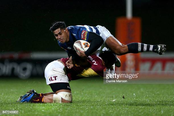 Malakai Fekitoa of Auckland is tackled by Neria Fomai of Southland during the round five Mitre 10 match between Southland and Auckland at Rugby Park...