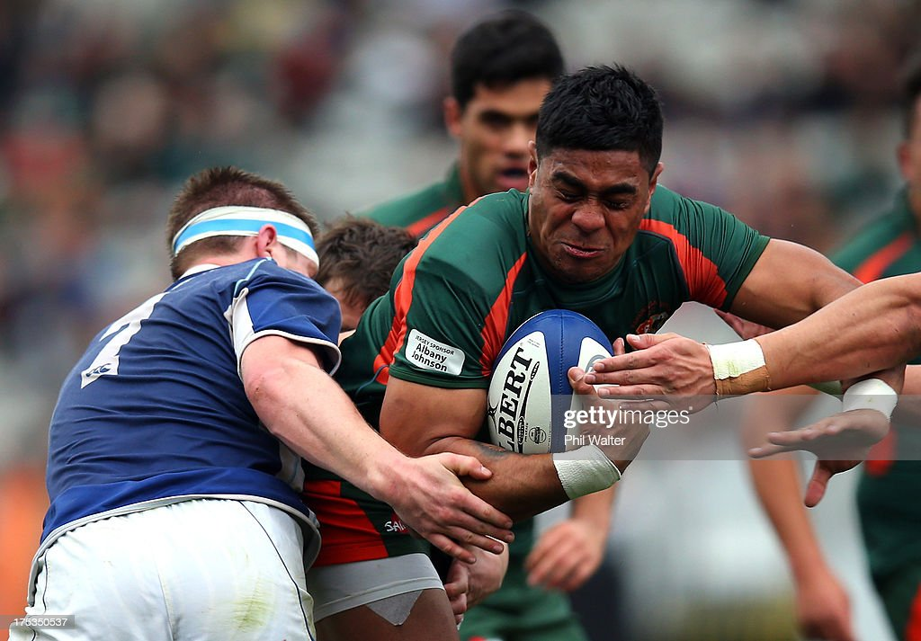 Malakai Fekitoa of Pakuranga is tackled during the Gallaher Shield Final match between Pakuranga and University at Eden Park on August 3, 2013 in Auckland, New Zealand.