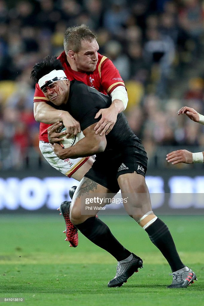 Malakai Fekitoa of the All Blacks is tackled by Gethin Jenkins of Wales during the International Test match between the New Zealand All Blacks and Wales at Westpac Stadium on June 18, 2016 in Wellington, New Zealand.