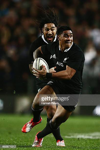 Malakai Fekitoa of the All Blacks makes a break during the International Test match between the New Zealand All Blacks and England at Waikato Stadium...
