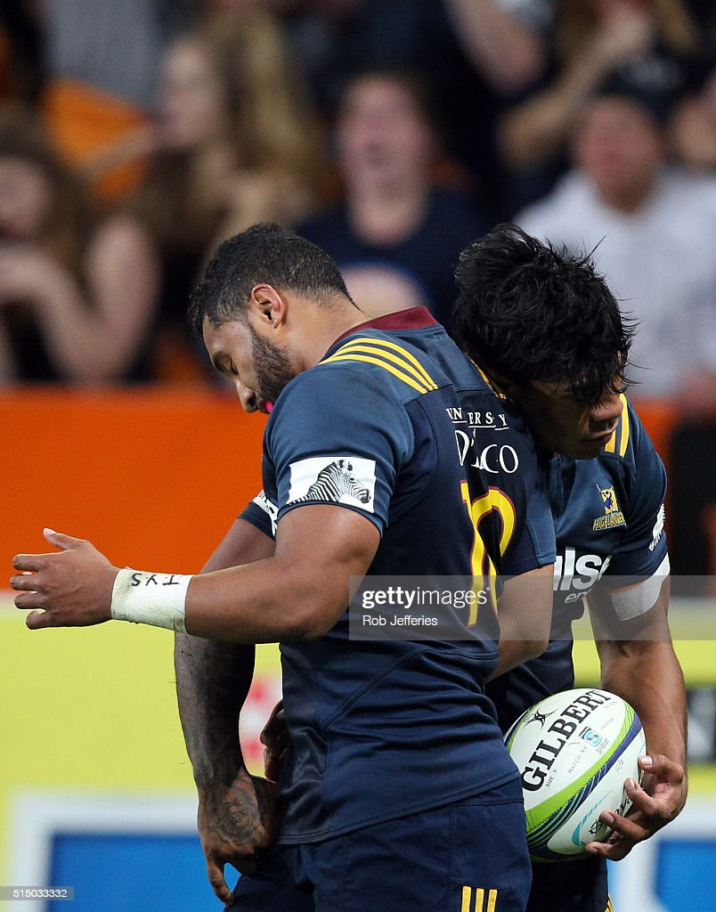 Malakai Fekitoa of the Highlanders celebrates his try with Lima Sopoaga during the round three Super Rugby match between the Highlanders and the Lions at Rugby Park on March 12, 2016 in Dunedin, New Zealand.