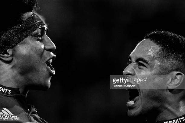 Malakai Fekitoa of the Highlanders celebrates his try with team mate Aaron Smith during the round seven Super Rugby match between the Highlanders and...
