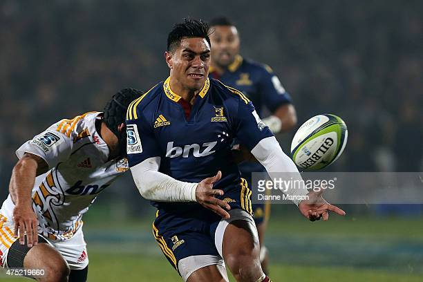 Malakai Fekitoa of the Highlanders gets a pass away during the round 16 Super Rugby match between the Highlanders and the Chiefs at Rugby Park...