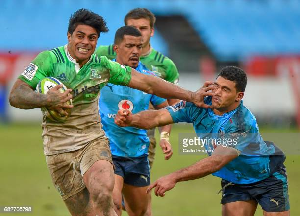 Malakai Fekitoa of the Highlanders handing of Jade Stighling of the Bulls during the Super Rugby match between Vodacom Bulls and Highlanders at...