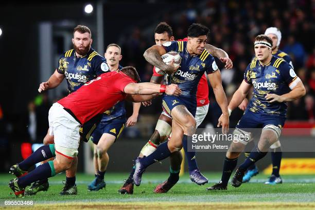 Malakai Fekitoa of the Highlanders makes a break during the match between the Highlanders and the British Irish Lions at Forsyth Barr Stadium on June...
