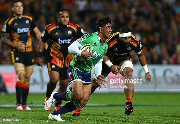 Malakai Fekitoa of the Highlanders makes a break during the round four Super Rugby match between the Chiefs and the Highlanders at Waikato Stadium on...