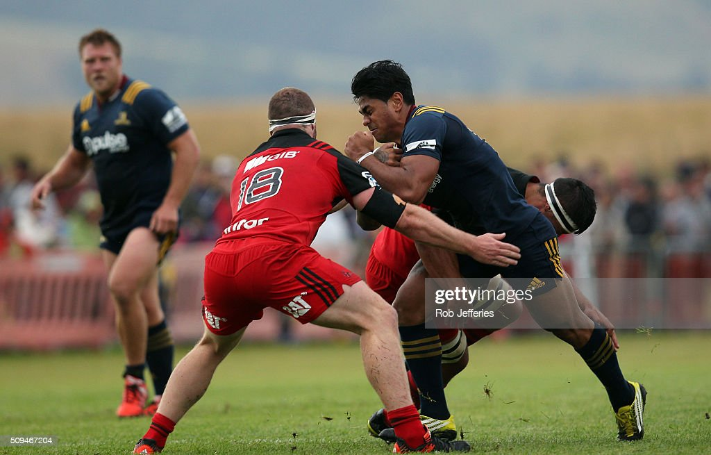 <a gi-track='captionPersonalityLinkClicked' href=/galleries/search?phrase=Malakai+Fekitoa&family=editorial&specificpeople=9630619 ng-click='$event.stopPropagation()'>Malakai Fekitoa</a> of the Highlanders on the charge during the Super Rugby trial match between the Highlanders and the Crusaders at Fred Booth Park on February 11, 2016 in Waimumu, New Zealand.