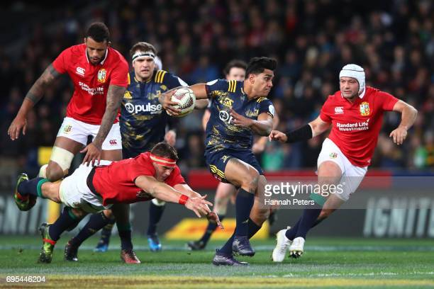 Malakai Fekitoa of the Highlanders splits the Lions defence during the 2017 British Irish Lions tour match between the Highlanders and the British...