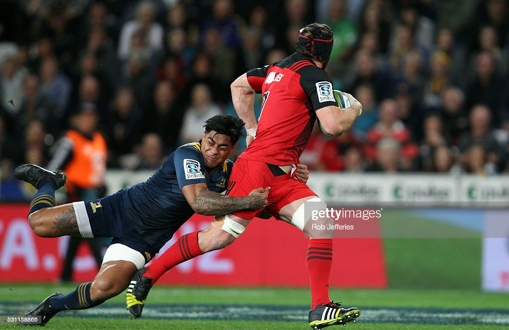<a gi-track='captionPersonalityLinkClicked' href=/galleries/search?phrase=Malakai+Fekitoa&family=editorial&specificpeople=9630619 ng-click='$event.stopPropagation()'>Malakai Fekitoa</a> of the Highlanders tackles <a gi-track='captionPersonalityLinkClicked' href=/galleries/search?phrase=Matt+Todd&family=editorial&specificpeople=5870233 ng-click='$event.stopPropagation()'>Matt Todd</a> of the Crusaders during the round twelve Super Rugby match between the Highlanders and the Crusaders at Forsyth Barr Stadium on May 13, 2016 in Dunedin, New Zealand.
