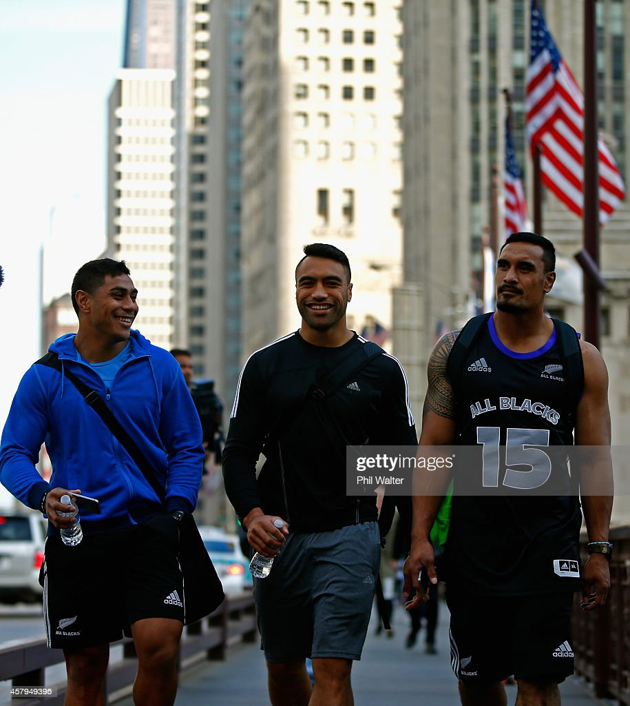 Malakai Fekitoa Victor Vito and Jerome Kaino of the New Zealand All Blacks take in a bit of sightseeing as they walk along Michigan Ave following a...