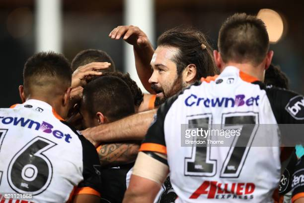 Malakai WateneZelezniak of the Tigers celebrates with team mates after scoring a try during the round 20 NRL match between the Wests Tigers and the...