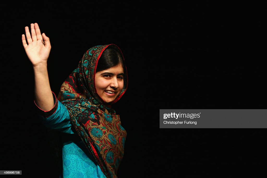 <a gi-track='captionPersonalityLinkClicked' href=/galleries/search?phrase=Malala+Yousafzai&family=editorial&specificpeople=5849423 ng-click='$event.stopPropagation()'>Malala Yousafzai</a> acknowledges the crowd at a press conference at the Library of Birmingham after being announced as a recipient of the Nobel Peace Prize, on October 10, 2014 in Birmingham, England. The 17-year-old Pakistani campaigner, who lives in Britain where she received medical treatment following an assassination attempt by the Taliban in 2012, was jointly awarded the Nobel peace prize with Kailash Satyarthi from India. Chair of the Nobel Committee Thorbjorn Jagland made the announcement in Oslo, commending Malala for her 'heroic struggle' as a spokesperson for girls' rights to education.