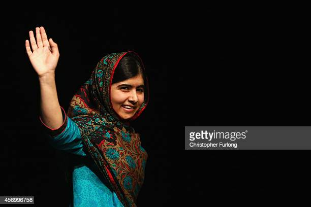 Malala Yousafzai acknowledges the crowd at a press conference at the Library of Birmingham after being announced as a recipient of the Nobel Peace...