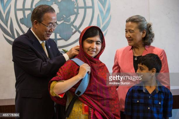 Malala Yousafzai an education and women's rights activist is given the gift of a backpack from United Nations Secretary General Ban KiMoon on August...
