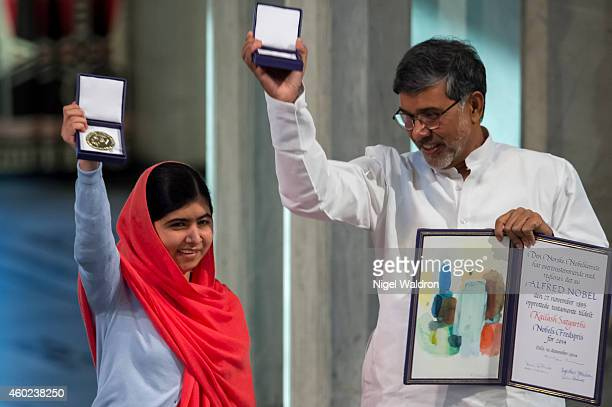 Malala Yousafzai and Kailash Satyarthi accept the Nobel Peace Prize Award during the Nobel Peace Prize ceremony at Oslo City Town Hall on December 10...
