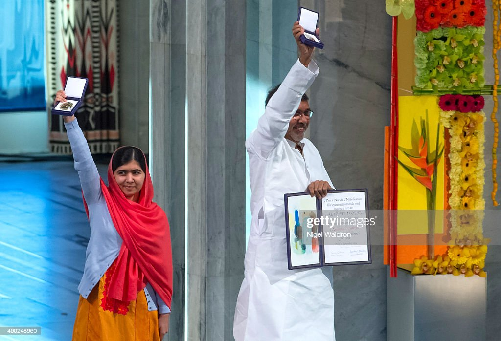 Malala Yousafzai and Kailash Satyarthi accept their Nobel Peace Prize Awards during the Nobel Peace Prize ceremony at Oslo City Town Hall on December...