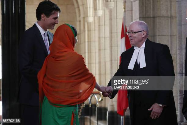 Malala Yousafzai and the Canadian Prime Minister Justin Trudeau arrives to shake the hands of the Senate Speaker Geoff Furey in Ottawa Ontario April...