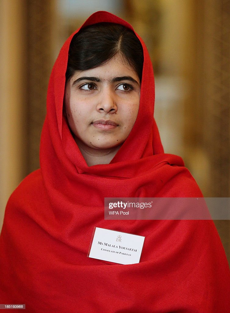 <a gi-track='captionPersonalityLinkClicked' href=/galleries/search?phrase=Malala+Yousafzai&family=editorial&specificpeople=5849423 ng-click='$event.stopPropagation()'>Malala Yousafzai</a> attends a Reception for Youth, Education and the Commonwealth with Queen Elizabeth II at Buckingham Palace on October 18, 2013 in London, England.