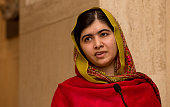 Malala Yousafzai gives a speech as she unveils her official portrait by artist Nasser Azam at Barbar Institute Of Fine Art on November 29 2015 in...