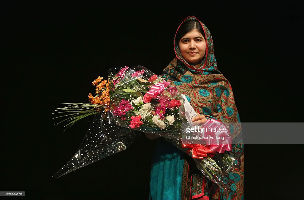 <a gi-track='captionPersonalityLinkClicked' href=/galleries/search?phrase=Malala+Yousafzai&family=editorial&specificpeople=5849423 ng-click='$event.stopPropagation()'>Malala Yousafzai</a> holds a bouquet of flowers, given to her on behalf of the Pakistani Prime Minster during a press conference at the Library of Birmingham after being announced as a recipient of the Nobel Peace Prize, on October 10, 2014 in Birmingham, England. The 17-year-old Pakistani campaigner, who lives in Britain where she received medical treatment following an assassination attempt by the Taliban in 2012, was jointly awarded the Nobel peace prize with Kailash Satyarthi from India. Chair of the Nobel Committee Thorbjorn Jagland made the announcement in Oslo, commending Malala for her 'heroic struggle' as a spokesperson for girls' rights to education.