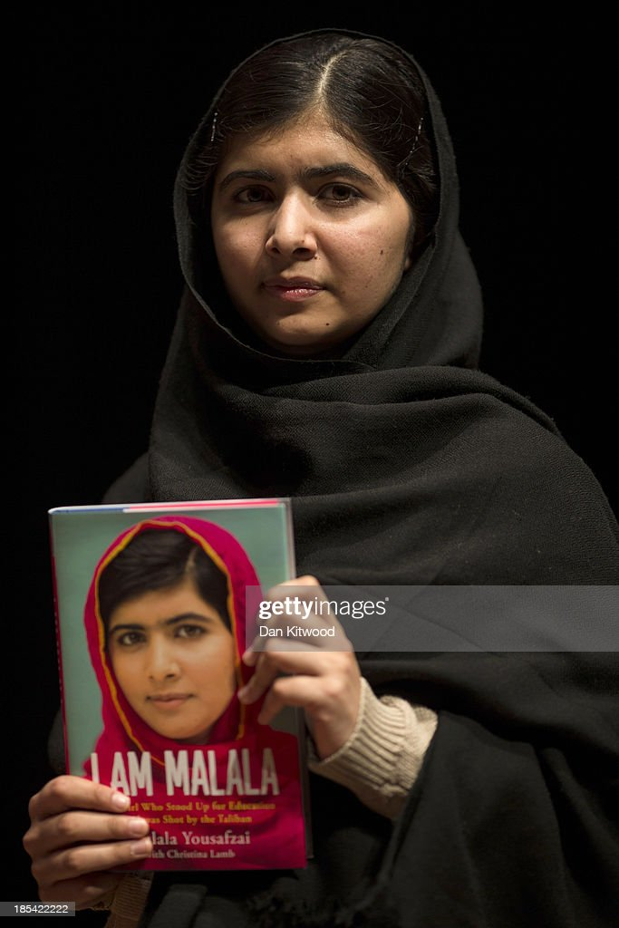 <a gi-track='captionPersonalityLinkClicked' href=/galleries/search?phrase=Malala+Yousafzai&family=editorial&specificpeople=5849423 ng-click='$event.stopPropagation()'>Malala Yousafzai</a> holds her memoir, 'I Am Malala' during a photocall at the South Bank centre on October 20, 2013 in London, England. The 16-year-old was shot by the Taliban for championing girls' rights to an education in the Swat Region in Pakistan in 2012.