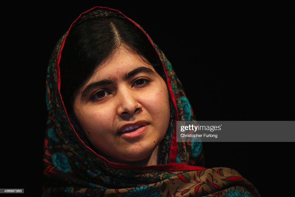 Malala Yousafzai looks on during a press conference at the Library of Birmingham after being announced as a recipient of the Nobel Peace Prize on...