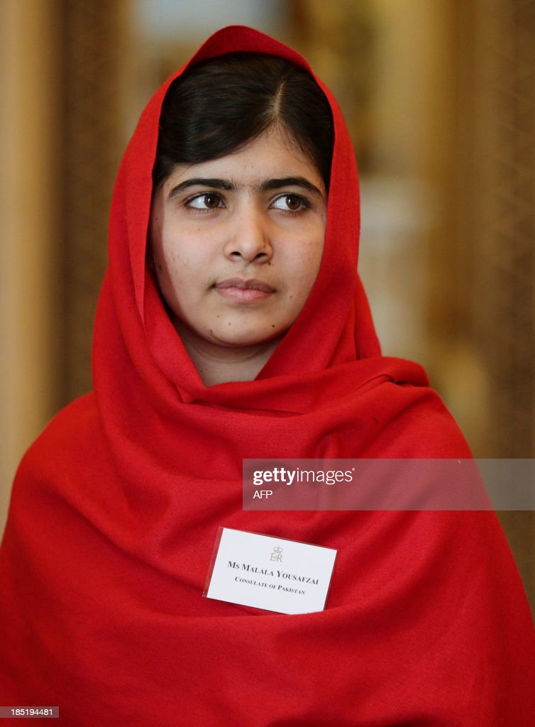 Malala Yousafzai looks on during a Reception for Youth, Education and the Commonwealth at Buckingham Palace in London on October 18, 2013. The 16-year-old, who was shot by the Taliban for championing girls' rights to an education, met Queen Elizabeth at a reception for youth, education and the Commonwealth. Prince Philip, 92, joked that in Britain, people wanted their children to go to school to get them out of the house -- a comment that left Malala covering her face in a fit of giggles. AFP PHOTO/POOL/Yui Mok