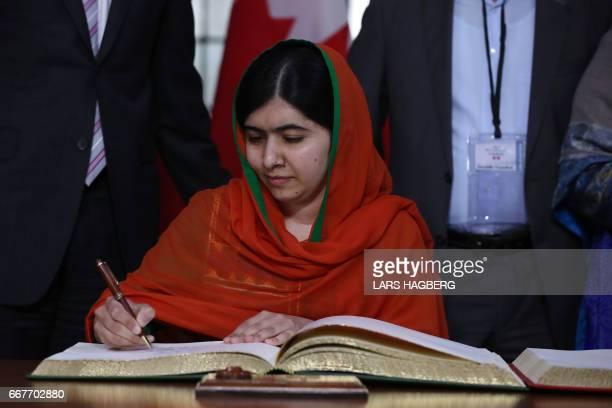 Malala Yousafzai signs a guest book at Parliament Hill in Ottawa Ontario April 12 2017 Malala Yousafzai will receive an honorary Canadian citizenship...