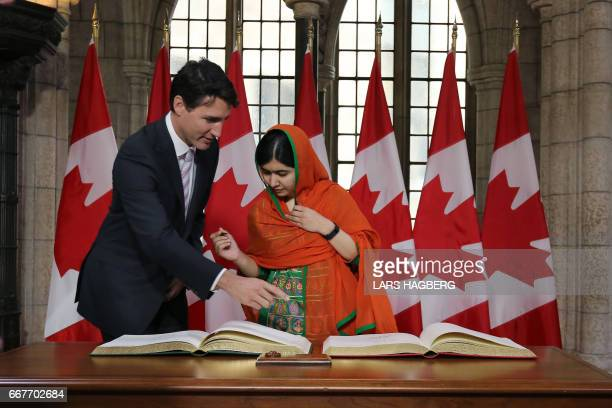 Malala Yousafzai signs a guest book with the Canadian citizenship from the Canadian Prime Minister Justin Trudeau in Ottawa Ontario April 12 2017...
