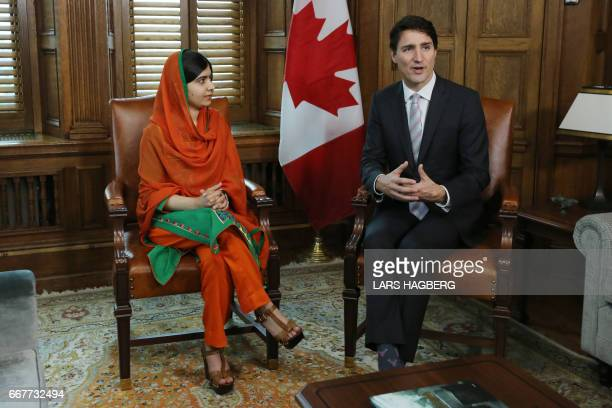 Malala Yousafzai speaks with the Canadian Prime Minister Justin Trudeau in Trudeau's office on Parliament Hill in Ottawa Ontario April 12 2017 Malala...