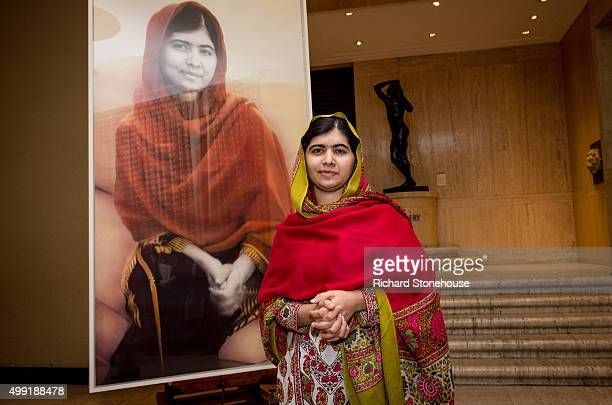 Malala Yousafzai unveils her official portrait by artist Nasser Azam at Barbar Institute Of Fine Art on November 29 2015 in Birmingham England