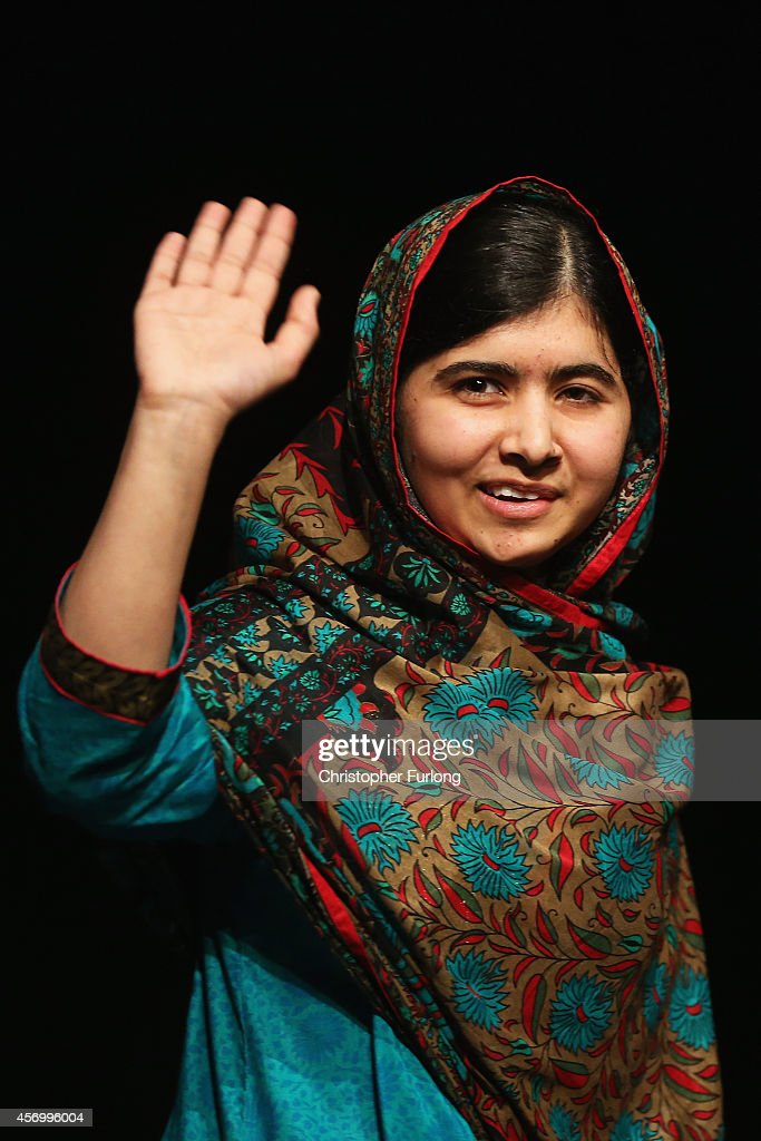 Malala Yousafzai waves to the crowd at a press conference at the Library of Birmingham after being announced as a recipient of the Nobel Peace Prize, on October 10, 2014 in Birmingham, England. The 17-year-old Pakistani campaigner, who lives in Britain where she received medical treatment following an assassination attempt by the Taliban in 2012, was jointly awarded the Nobel peace prize with Kailash Satyarthi from India. Chair of the Nobel Committee Thorbjorn Jagland made the announcement in Oslo, commending Malala for her 'heroic struggle' as a spokesperson for girls' rights to education.