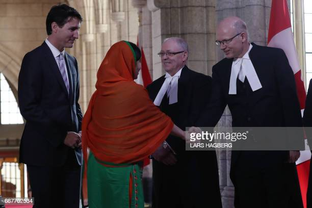 Malala Yousafzai with Canadian Prime Minister Justin Trudeaushake hands as they arrive in Ottawa Ontario April 12 2017 Malala Yousafzai will receive...