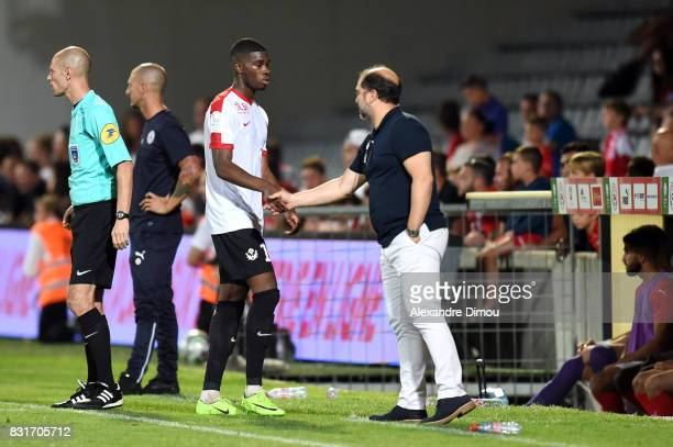 Malaly Dembele and Pablo Correa Coach of Nancy during the Ligue 2 match between Nimes Olympique and As Nancy Lorraine at Stade des Costieres on...