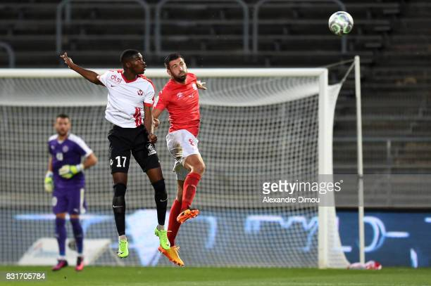 Malaly Dembele of Nancy and Pierrick Valdivia of Nimes during the Ligue 2 match between Nimes Olympique and As Nancy Lorraine at Stade des Costieres...