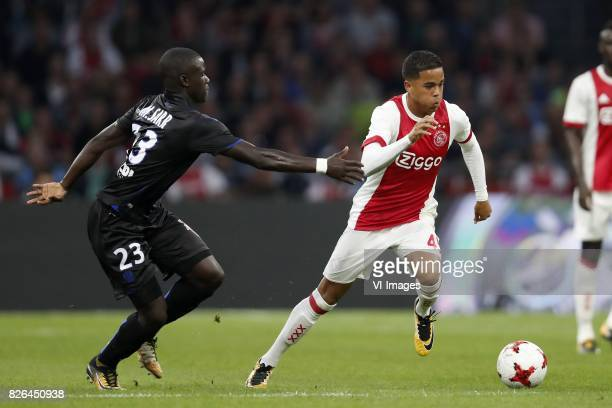 Malang Sarr of OCG Nice Justin Kluivert of Ajax during the UEFA Champions League third round qualifying first leg match between Ajax Amsterdam and...