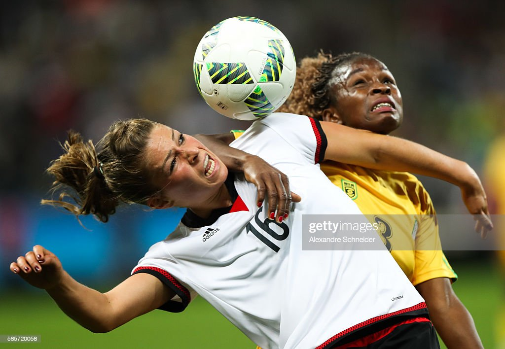 Malanie Leupolz (L) of Germany and Sheila Makoto of Zimbabwe in action during the match between Zimbabwe and Germany for summer olympics at Arena Corinthians on August 3, 2016 in Sao Paulo, Brazil.