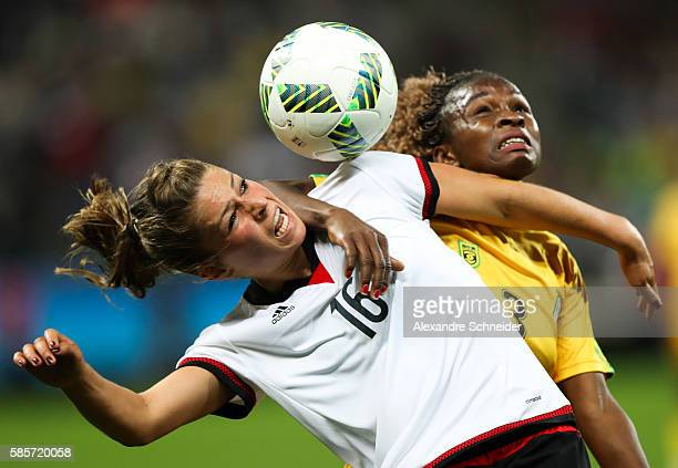 Malanie Leupolz of Germany and Sheila Makoto of Zimbabwe in action during the match between Zimbabwe and Germany for summer olympics at Arena...