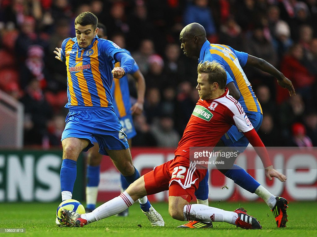 Malaury Martin of Middlesbrough tackles Terry Gornell of Shrewsbury during the FA Cup Third Round match between Middlesbrough and Shrewsbury Town at Riverside Stadium on January 7, 2012 in Middlesbrough, England.