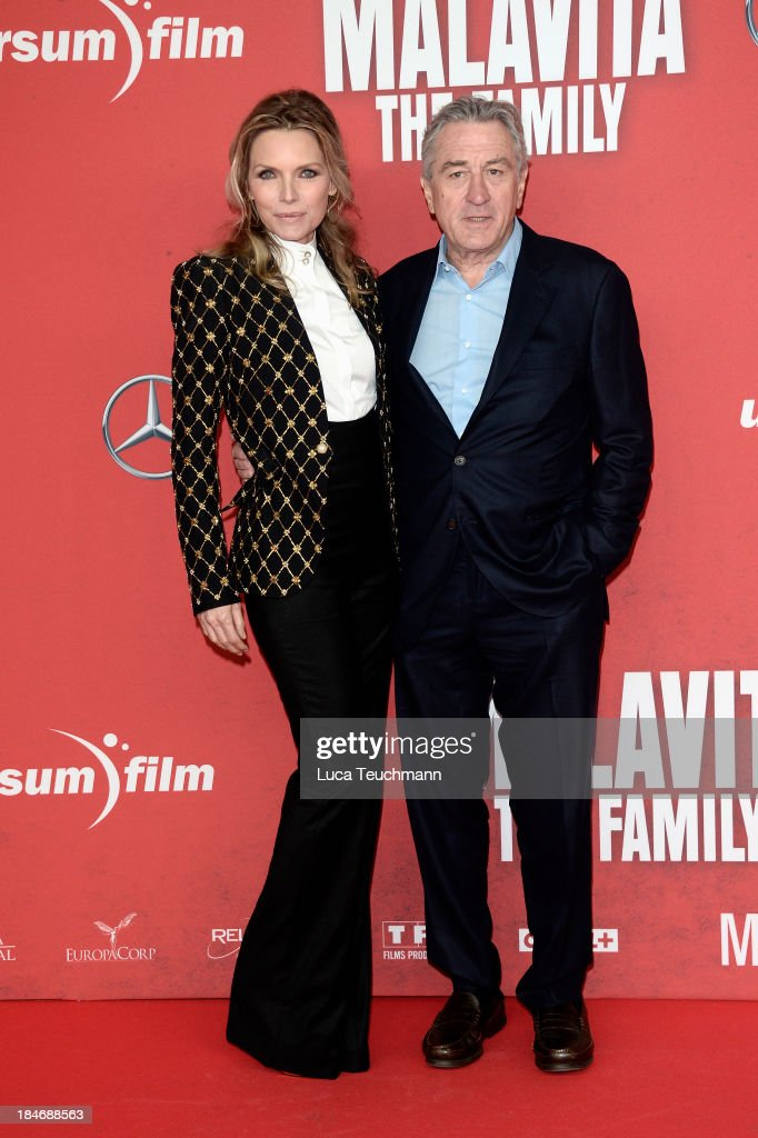 Michelle Pfeiffer and Robert De Niro attend the 'Malavita The Family' Germany Premiere at Kino in der Kulturbrauerei on October 15 2013 in Berlin...