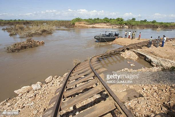 A Malawi Defence Force marine boat awaits on January 21 2015 to rescue victims of the recent floods who were trapped by the waters at a Shire River...