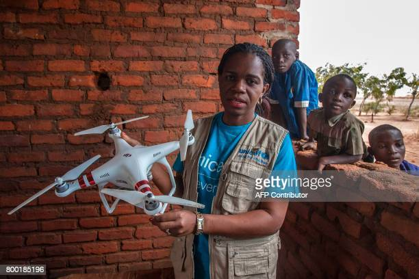 Malawi's Communication Officer Doreen Matonga presents a drone during a visit by journalist on June 22 in regards to humanitarian drone corridor...