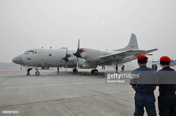 LUMPUR Malaysia A P3C patrol plane of Japan's Maritime SelfDefense Force arrives at an air base near Kuala Lumpur on March 14 to join international...